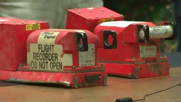 The handover of the flight recorders starts the investigation into what happened to the Malaysian airliner.  (Source: CNN)
