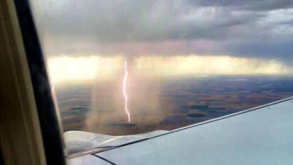 Air traveler Gina Hyams caught an epic cloud-to-ground lightning strike 10 minutes outside Denver International Airport on Thursday. (Source: Gina Hyams/labelldame/Twitter)