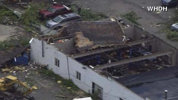 A strong storm ripped off roofs and downed trees outside of Boston. (Source: WHDH/CNN)