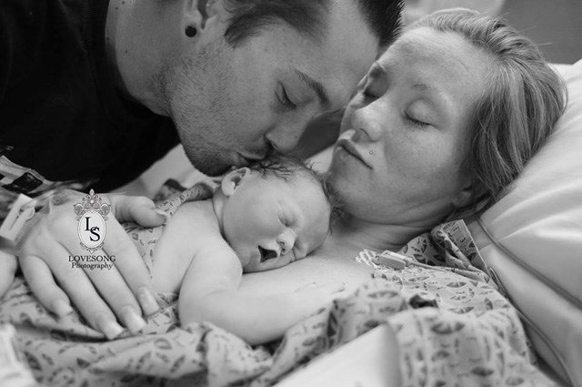 Richard and Emily Staley hold their daughter, Monroe Faith. (Source: Love Song Events and Photography/Facebook)
