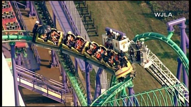 Twenty-four people had been stuck on the JOKER's Jinx roller coaster at Six Flags America since 2:30 p.m. ET on Sunday before their rescue began.  (Source: WJLA/CNN)