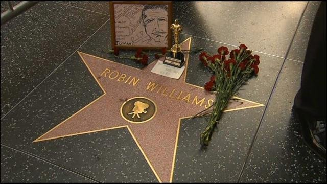 Tokens of love and appreciation have been left at Williams' star on the Hollywood Walk of Fame on Monday. (Source: CNN)