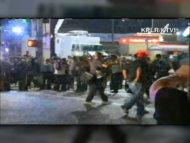 Police line the street in a tense stand off with protesters marching on Monday night in Ferguson, MO. (Source: CNN)