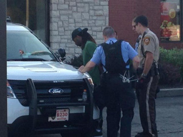 Police make an arrest at the McDonald's in Ferguson, MO, on Monday. (Source: Mike Mohundro/KFVS12)