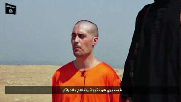 James Wright Foley is shown shortly before his execution at the hands of ISIS extremists. (Source: ISIS/CNN)