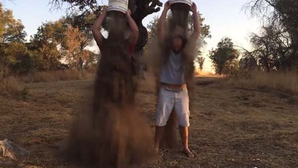 Two men in California modified the Ice Bucket Challenge because of the drought affecting their state. (Source: CDub/YouTube)
