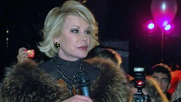 In addition to her famous job as a professional gossip, Joan Rivers was also an Emmy Award winner and playwright. (Source: Wiki Commons/MGN Online)