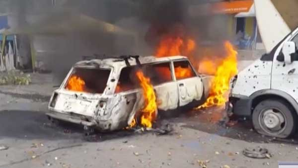 A car burns on the streets of Donetsk in eastern Ukraine as fighting between pro-Russian separatists and Ukraine national forces intensifies.  (Source: Radio Free Europe/CNN)