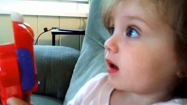 A space shuttle launch left this little girl nearly speechless. (Source: Keith Zerfas/YouTube)