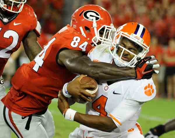 Georgia linebacker Leonard Floyd tackles Clemson quarterback Deshaun Watson. (Source: Georgia Athletics)
