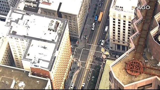 A window washer fell onto a moving car while working Friday in San Francisco. (Source: KGO/CNN)