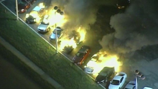 Cars blaze at a dealership in Dellwood, MO, Tuesday morning. (Source: Pool/CNN)