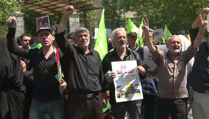 Iranians rally on Friday to show solidarity with Palestinians.  (Source: CNN)