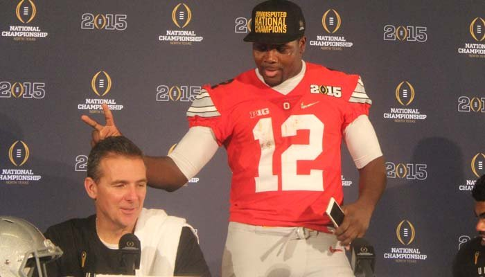 Ohio State quarterback Cardale Jones goofs around with coach Urban Meyer after winning the national championship. Jones is in a battle with J.T. Barrett and whomever wins could be a Heisman frontrunner. (Source: Brian Tynes/RNN)