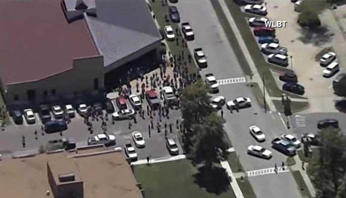 Police will ask you to raise your hands as they sweep a building for the shooter.  (Source: WLBT)