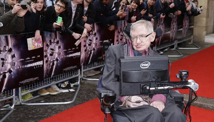 Stephen Hawking poses for photographers upon arrival for the Interstellar Live show at the Royal Albert Hall in central London on March 30, 2015. (Photo by Joel Ryan/Invision/AP)
