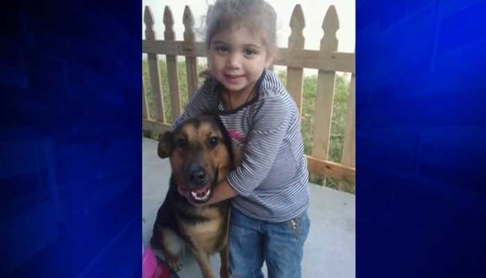 In a family photo, Buffy poses with the Frederick's young daughter. Buffy, Antonio Frederick's PTSD therapy dog, and another family dog were shot and killed by the family's neighbor on Monday. (Soiurce: WSVN, family photos/Miami-Dade FL Police/CNN)