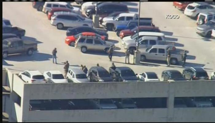 Armed police on the top floor of the parking deck at Will Rogers World Airport in Oklahoma City. (Source: KOCO/CNN)