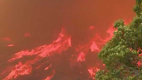 Two teens are being questioned after being arrested for starting brush fires near San Diego where fires have scorched hundreds of acres of land and caused thousands of people to be evacuated.  (Source: CNN)