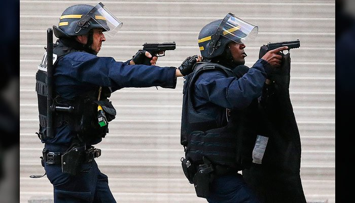Police forces operate in Saint-Denis, a northern suburb of Paris, Wednesday. Police say two suspects in last week's Paris attacks, a man and a woman, were killed. (AP Photo/Francois Mori)