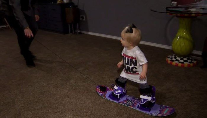 To get her two wobbly legs comfortable on one solid board, the family practiced carefully pulling cash across the living room floor. (Source: KBOI/CNN)