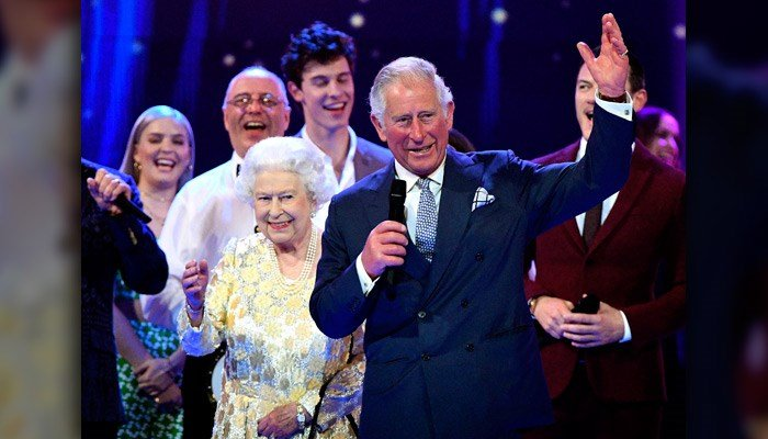 Queen Elizabeth II and the Prince Charles stand with performers on stage at at the Royal Albert Hall in London on April 21 for a concert to celebrate the queen's 92nd birthday. (Andrew Parsons/Pool via AP)