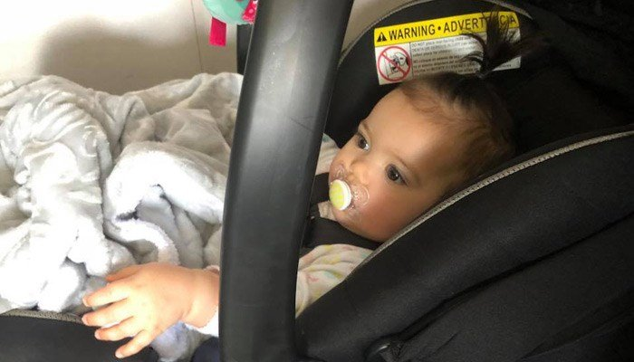 Cassie Hutchins was flying with her 8-month-old on Sunday when a gate agent told her the baby's rear-facing car seat must face forward. (Source: Cassie Ann/Facebook)