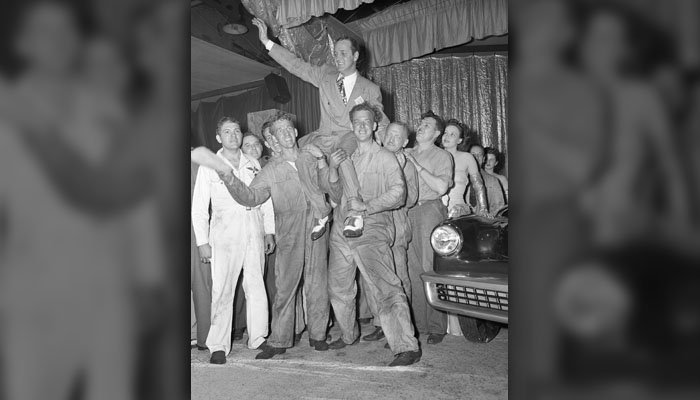 Preston Tucker is hoisted on the shoulders of mechanics on June 23, 1947 in Chicago, as the new Tucker, a hand-made model, is presented to dealers and distributors who attended a special showing of the car. (AP Photo)