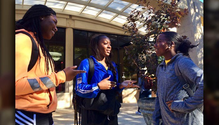 From left to right, Kennedy Town, Shlondra Young and Toomia Dean talk outside the student center on the school's campus in Kennesaw, Ga., Monday, Oct. 16, 2017. (AP Photo/Jeff Martin)