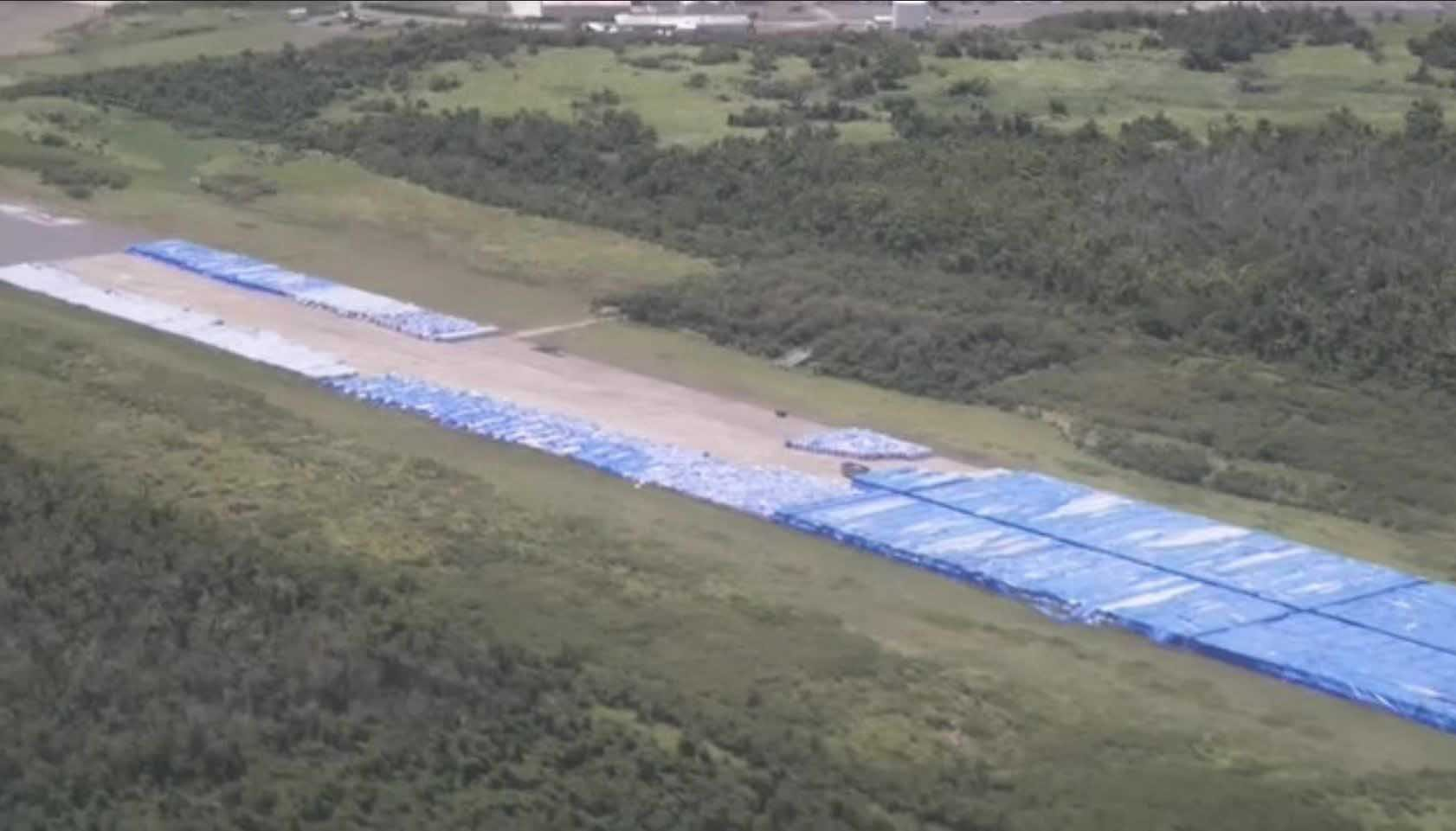 Around 20,000 pallets of bottled water are going to waste on an airport runway in Puerto Rico. (Source: CNN)