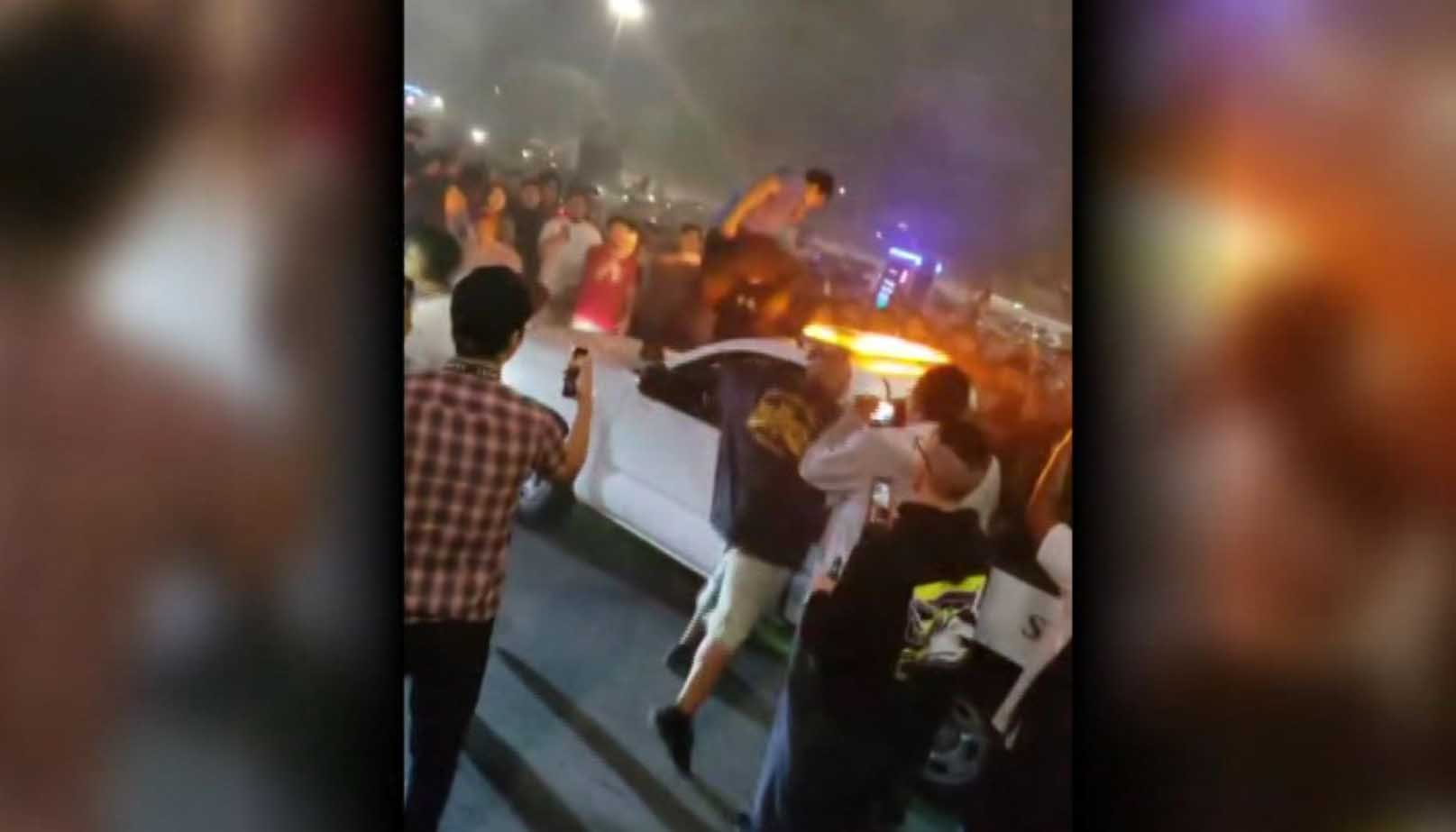 "Multiple videos posted on social media show the chaos that broke out at a tribute to ""Fast and the Furious"" star Paul Walker. (Source: KCAL/KCBS/West Covina Police Department/CNN)"