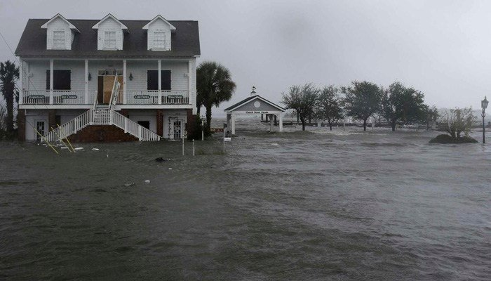 High winds and water surround a house as Hurricane Florence hits Swansboro, NC, Friday, Sept. 14, 2018. (AP Photo/Tom Copeland)