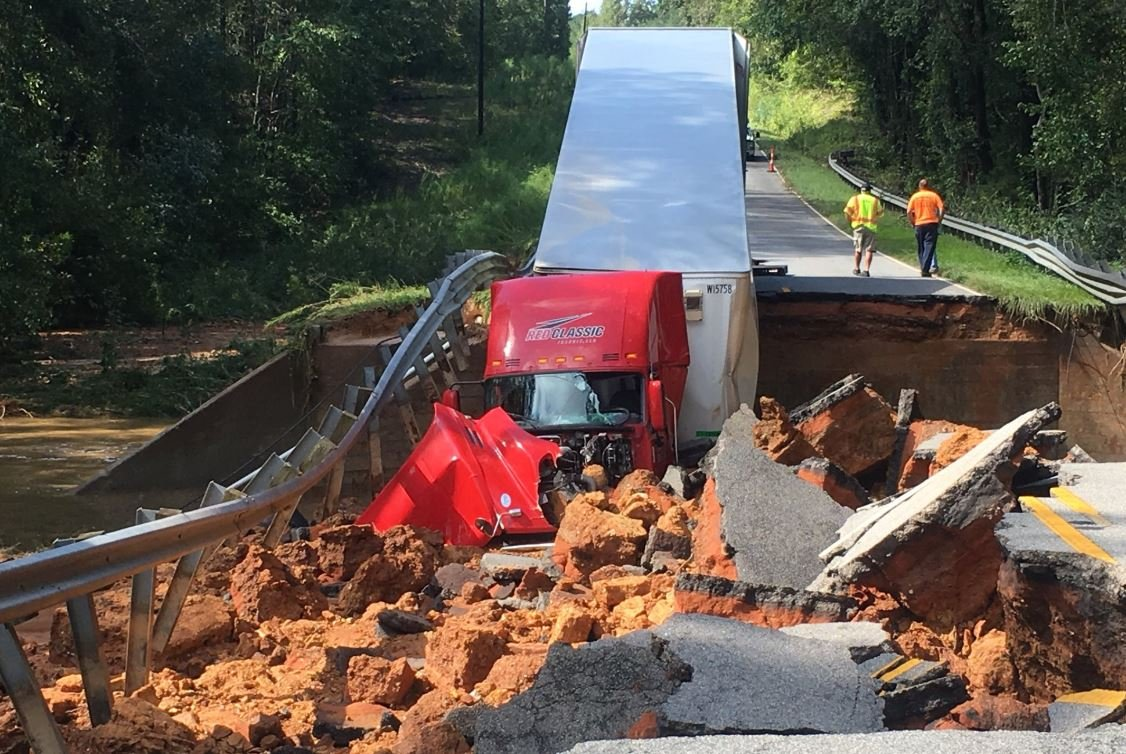 The driver of a tractor trailer is OK after the road beneath him collapsed in South Carolina. (Source: Horry County Fire Rescue)