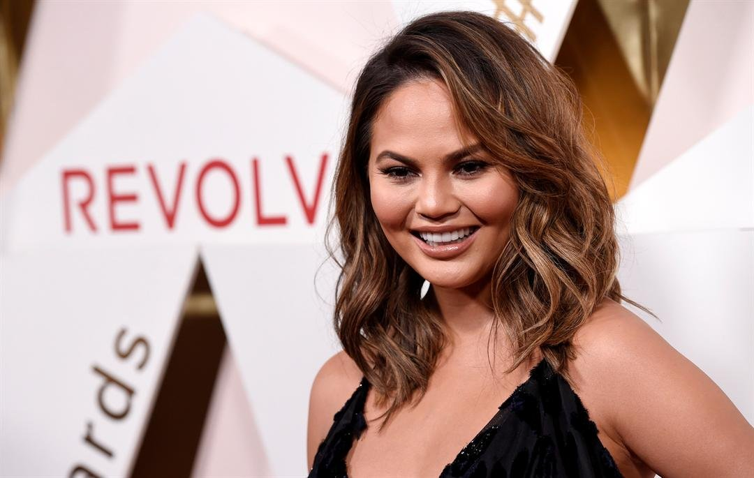 Honoree Chrissy Teigen poses at the 2017 Revolve Awards at the Dream Hollywood hotel on Thursday, Nov. 2, 2017, in Los Angeles. (Photo by Chris Pizzello/Invision/AP)