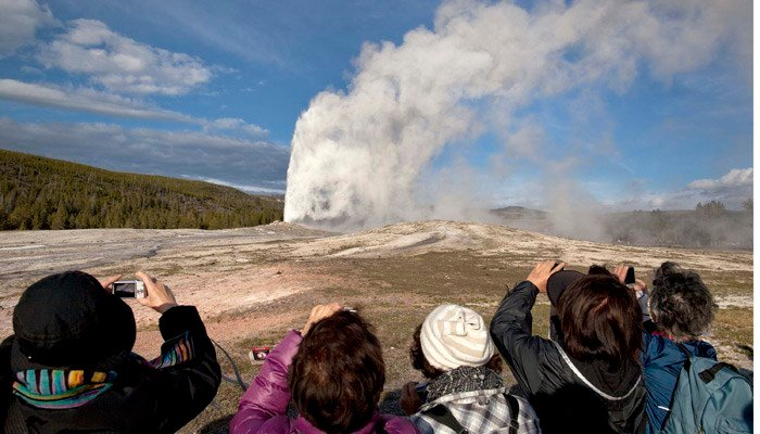 The scalding mist from Old Faithful can reach 90 to 120 feet into the air. (Source: Julie Jacobson/AP)