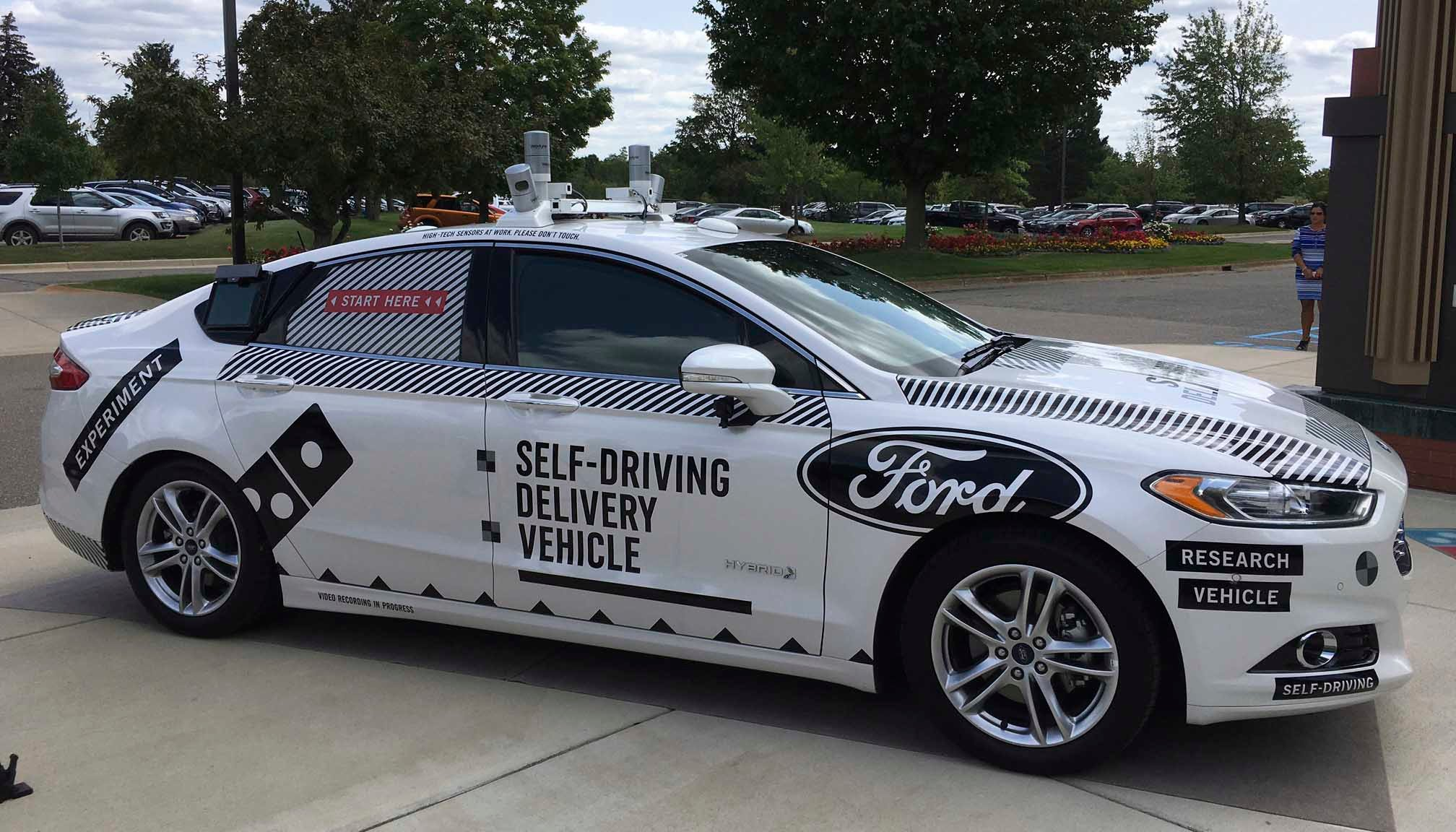 This Friday, Aug. 24, photo shows the specially designed delivery car that Ford Motor Co. and Domino's Pizza will use to test self-driving pizza deliveries, at Domino's headquarters in Ann Arbor, MI. (AP Photo/Dee-Ann Durbin)